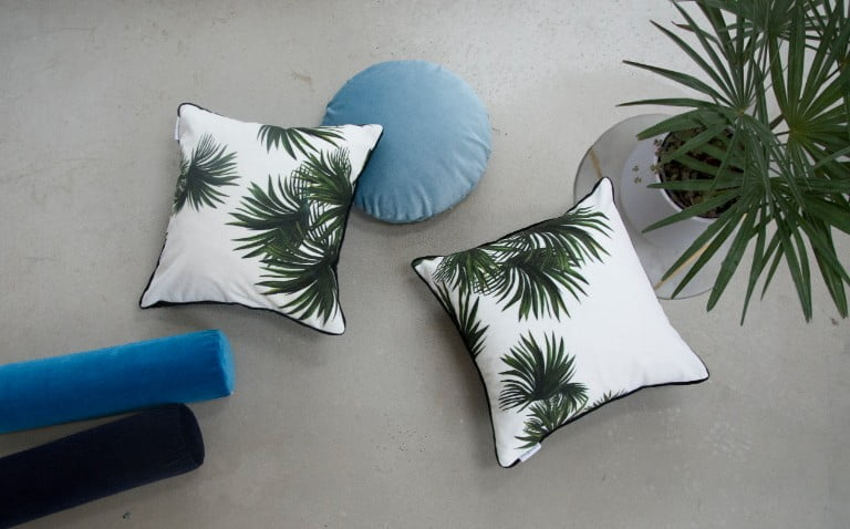 Handpicked by Kate Twilight palm £50, and velvet bolster cushions £40 lifestyle
