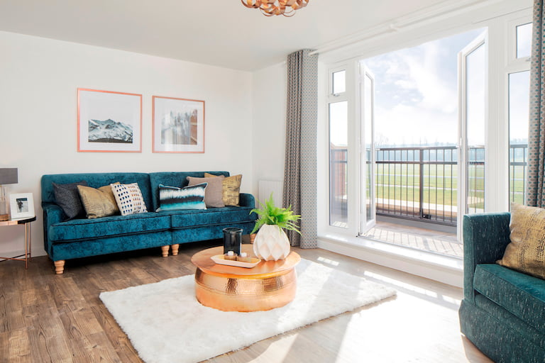 Modern blue sofa with round copper coffee table - Newbury Racecourse, David Wilson Homes